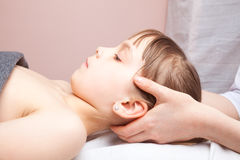 Girl receiving osteopathic treatment of her head Royalty Free Stock Photography