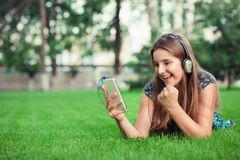 Girl receiving a sms message with good news in a mobile phone royalty free stock photo