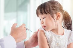 Free Girl Receiving Vaccination From Doctor At Hospital Royalty Free Stock Image - 99793246