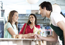 Girl Receiving Vanilla Ice Cream Cone From Waiter By Mother Stock Photography