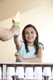 Girl Receiving Vanilla Ice Cream Cone From Waiter Royalty Free Stock Photos
