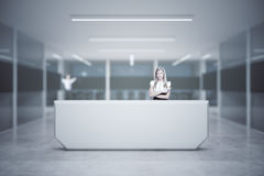 Girl at reception desk. Attractive european girl standing at reception desk in blurry interior. 3D Rendering stock photography