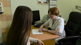 The girl on reception at the doctor. The girl on reception at the doctor HD stock footage