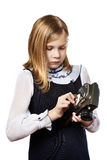 Girl recharges mechanism cameras Royalty Free Stock Photos