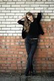 Girl recline on wall Stock Photo