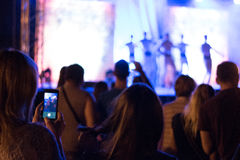 Girl recorded concert. Smartphone Snapshot at a concert Stock Photos