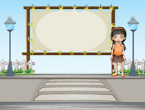 A girl beside a rectangular signage Stock Photo