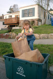 Girl recycling Stock Image