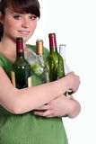 Girl recycling glass bottle Royalty Free Stock Photography