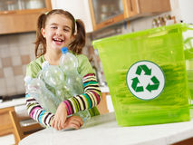 Free Girl Recycling Plastic Bottles Royalty Free Stock Photo - 11432535