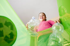 Girl recycling plastic bottles Royalty Free Stock Image