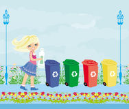 Girl recycling plastic bottles Stock Photos