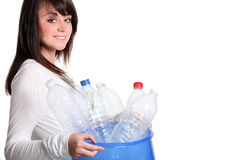 Girl recycling plastic bottles. Young girl recycling plastic bottles Royalty Free Stock Photos