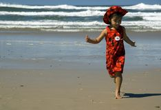 Girl in red 03. Girl in red dress running on the beach Royalty Free Stock Photos