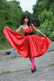 Girl in red. The beautiful girl in a fluttering red dress Stock Photo