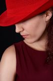 Girl in red 2. Girl with a red hat looking down Royalty Free Stock Photography