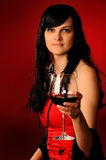 Girl in red. With  glass of wine Royalty Free Stock Images