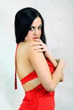 Girl in the red. The beautiful girl in a red dress royalty free stock photo
