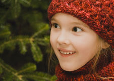 Girl in Red. Pretty little girl wearing a red knit hat and matching scarf Royalty Free Stock Photos