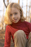 Girl in red. In the woods royalty free stock images