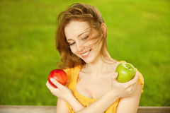 Girl with red apple Stock Photography