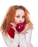 Girl with red apple. Red-haired girl with apple isolated on white Stock Image