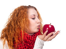 Girl with red apple. Red-haired girl with apple isolated on white Royalty Free Stock Photo