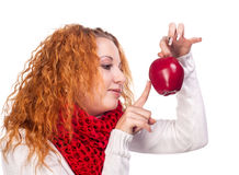 Girl with red apple. Red-haired girl with apple isolated on white Royalty Free Stock Images