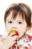 Girl and red apple Stock Images