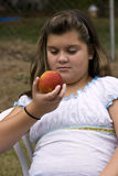 Girl with red apple Royalty Free Stock Photos