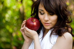 Girl with red apple. Wonderful girl with red apple Stock Image