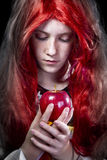Girl with red apple in a poetic representation Royalty Free Stock Photo