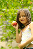 Girl with red apples Stock Photos