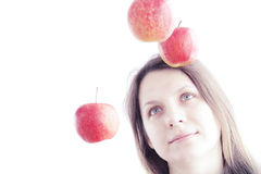 Girl and red apples stock image