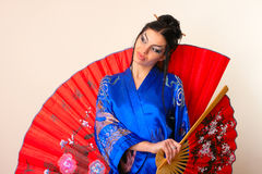 Girl with red asian fan Stock Photos