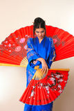 Girl with red asian fan Royalty Free Stock Photography