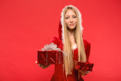 Girl on a red background holds gift box Stock Image