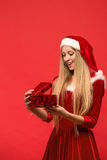 Girl on a red background holds gift box Stock Photo