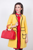 Girl with a red bag and dress in yellow Polten Royalty Free Stock Image