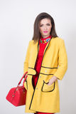 Girl with a red bag and dress in yellow Polten Royalty Free Stock Images