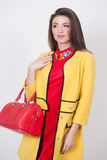 Girl with a red bag and dress in yellow Polten Stock Photography