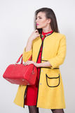 Girl with a red bag and dress in yellow Polten Stock Image
