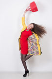 Girl with a red bag and dress in yellow Polten Stock Photos