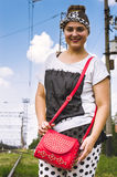 The girl with a red bag on railway station travels Royalty Free Stock Photography