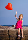 Girl with a red ball Royalty Free Stock Photos