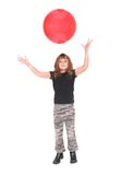 Girl with red ball Stock Photos