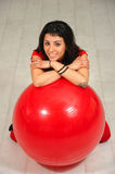 Girl and red ball. Gym woman holding a Pilates ball stock photo