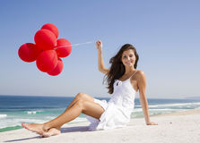 Girl with red ballons Royalty Free Stock Images