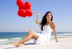 Girl with red ballons Stock Photo