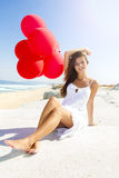 Girl with red ballons Stock Photography